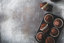 Chocolate brownies cacao muffins flat lay, baking concept, top view, copy space on dark background