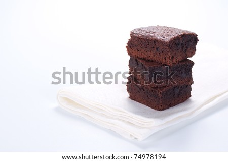 Chocolate brownies on white napkin