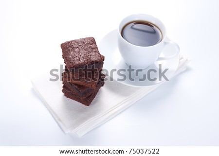 Chocolate brownies on white plate and two cups of coffee