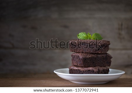 Chocolate brownies stacks on wooden background, homemade sweet and dessert #1377072941