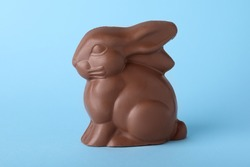 Chocolate bunny on light blue background. Easter celebration