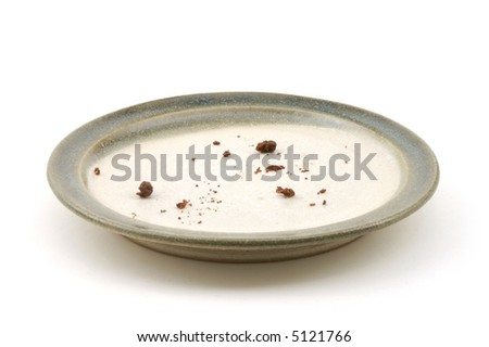 Chocolate cake crumbs sit on an empty plate.