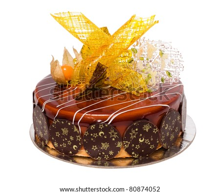 Chocolate cake decorated by caramel isolated on White