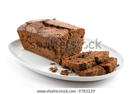 chocolate cake on a plate with two slices separately cut - stock photo