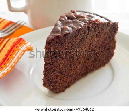 Chocolate Cake Slice on white dish.