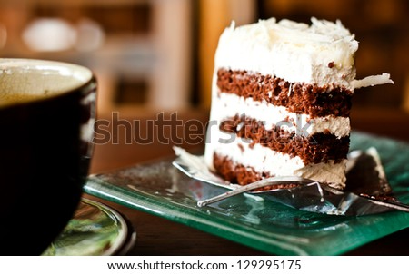 Chocolate cake with a cup of coffee - stock photo