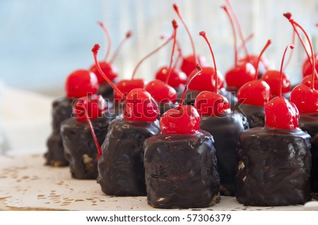 Chocolate cake with a red cherry
