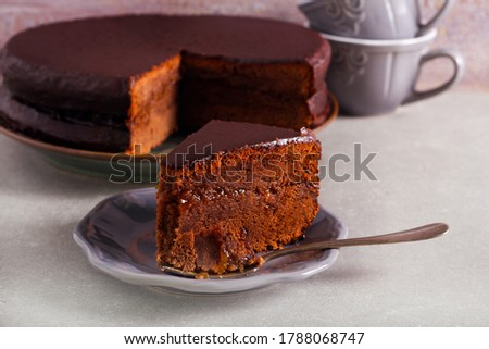 Chocolate cake with apricot jam filling, zacher cake, sliced and served Zdjęcia stock ©