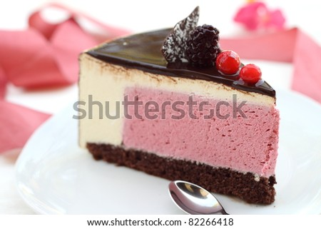 Chocolate cake with berries and cream mousse