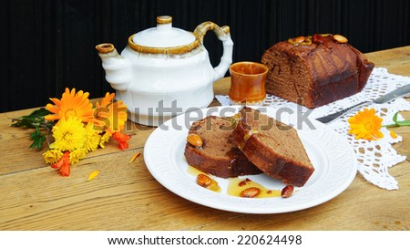 chocolate cake with candied lemon peels and teapot