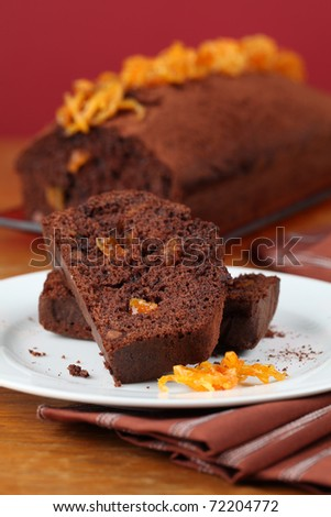 Chocolate cake with candied orange peel. Shallow dof - stock photo
