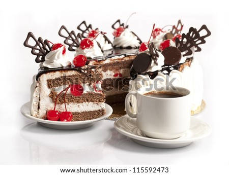 chocolate cake with cherry and  cup of coffee on white background