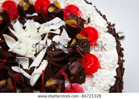 Chocolate cake with red  cherries