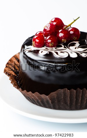Chocolate cake with redcurrants on white