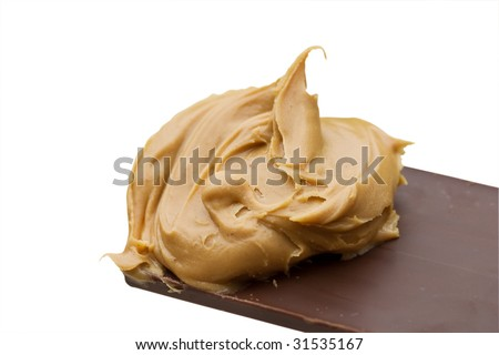 Chocolate candy bar dipped into peanut butter isolated over white background. Clipping path included.