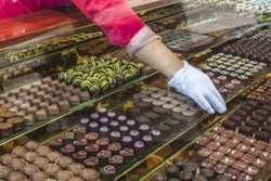 Chocolate candy in a store window. Stand with chocolates. Bulgaria