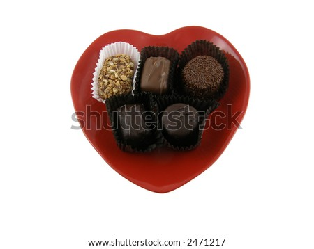 Chocolate candy on a heart shaped dish