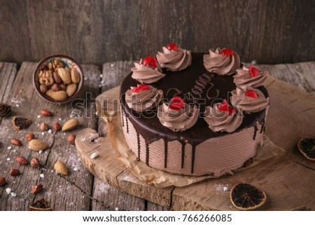 Chocolate caramel cake prague. Beautiful still life on wooden boards