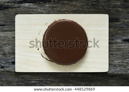Chocolate cheesecake on wood plate (Top view) #448529869