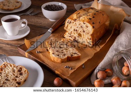 Chocolate chip cake with a cup of coffee on a wooden table