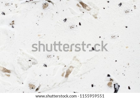 Chocolate chip cookie dough ice cream background viewed from above.