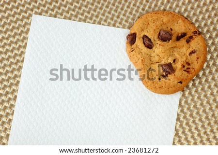 Chocolate chip cookie placed on top of a piece of napkin