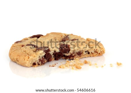 Chocolate chip cookie with a bite taken out and crumbs, isolated over white background.
