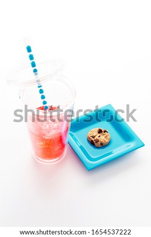 Chocolate chip cookie with drink on white background