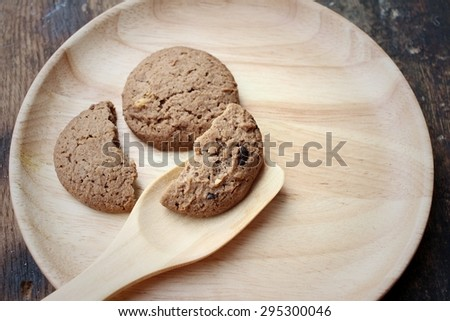 Chocolate chip cookies on background of brown. #295300046