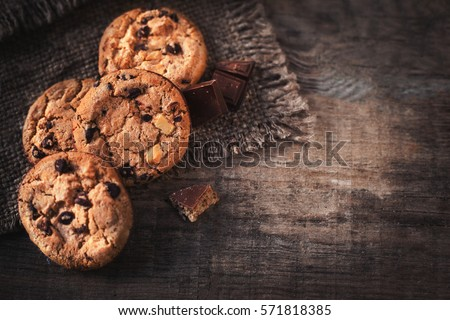 Chocolate chip cookies on dark old wooden table with place for text.,  freshly baked. Selective Focus with Copy space. #571818385