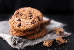 Chocolate chip cookies on dark  with place for text, freshly baked. Selective Focus with Copyspace. Choco cookie