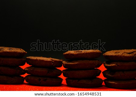 Chocolate chip cookies on red background