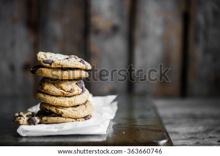 Chocolate chip cookies on rustic background