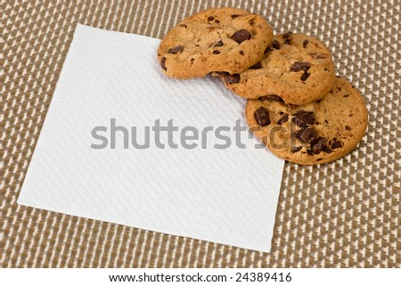 Chocolate chip cookies placed on top of a piece of napkin
