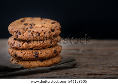 Chocolate chip cookies stacked up on a plate in low light, AF point selection #546189505