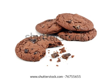 Chocolate chip cookies with bite missing on a white background