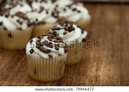 chocolate chip cupcakes on wooden kitchen table