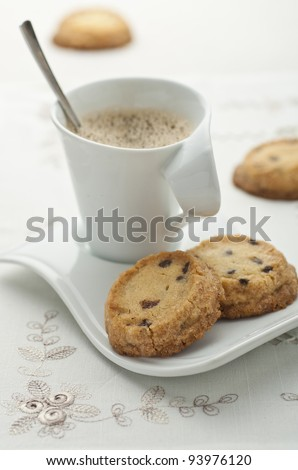 Chocolate chip vanilla cookies with a cup of coffee