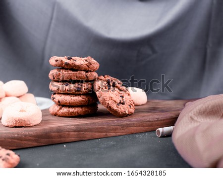 Chocolate chips cookies on a wooden board