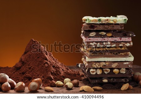 Chocolate / Chocolate bar / chocolate background/ nut chocolate / chocolate tower #410094496