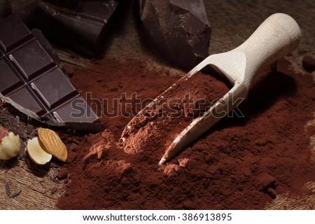 Chocolate / chocolate bar pieces / cocoa powder / chocolate background