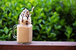 Chocolate coffee frappe for a hot summer day outside on the front porch