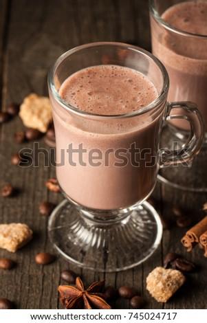 Chocolate, coffee, milk, banana shake on wooden background. Smoothie with cookies. Milkshake. Protein diet. Healthy food concept. #745024717
