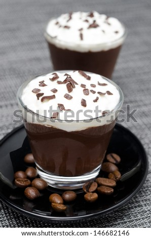 chocolate-coffee mousse with whipped cream in glasses, vertical