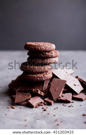 Chocolate cookies on a hill out of pieces of chocolate on gray background. Copyspace #451203433