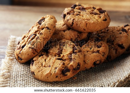 Chocolate cookies on wooden table.   #661622035