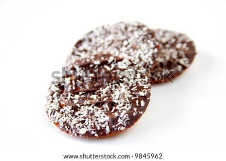 chocolate cookies sprinkled with coconut isolated on a white background.
