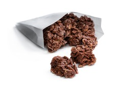 Chocolate  corn flake clusters in paper bag isolated on white