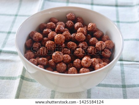 Chocolate Cornflakes in A Bowl, A Breakfast Cereal Made by Toasting Flakes of Corn or Maize. #1425184124
