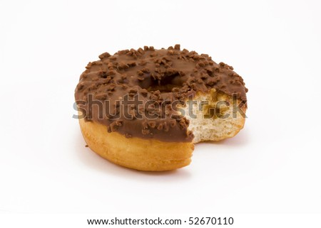 chocolate covered doughnut with a bite taken out over white